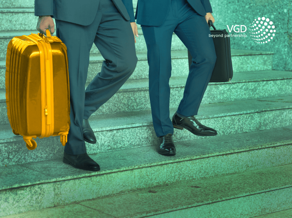 businessmen wearing suits with a gold suitcase
